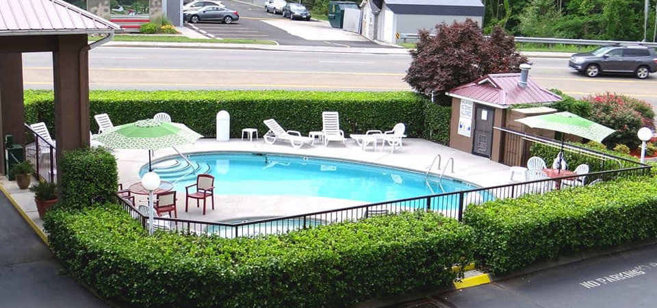 View of the Seasonal Outdoor Pool at the Baymont Inn and Suites Pigeon Forge Tn