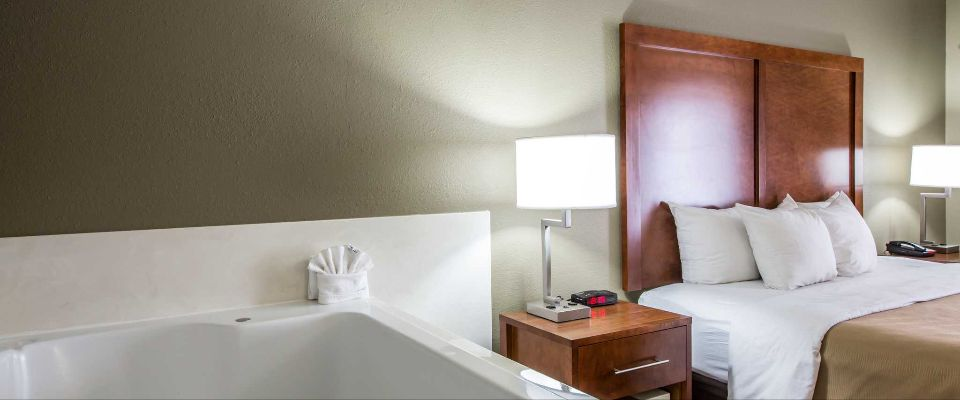 View of a King Room with in-room Jacuzzi Tub at the Comfort Inn and Suites at Dollywood Lane Pigeon Forge on the Parkway