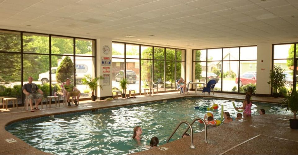View of the Indoor Heated Pool with glass enclosure at the Country Cascades in Pigeon Forge Tn