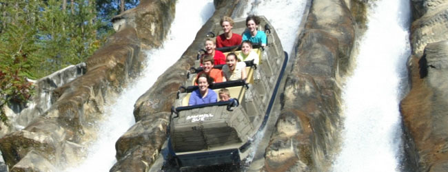 View of the Daredevil Falls Log Flume ride with guests having fun plunging from the main drop in Dollywood wide