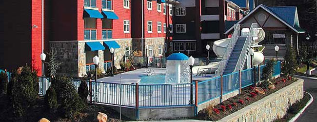 View of the Outdoor Pool with Water Slide at the Fairfield Inn and Suites in Gatlinburg North wide