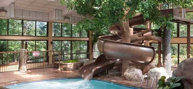indoor multi tier pool with indoor water slides at the park vista doubletree in gatlinburg