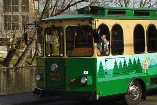 View of the Fun Time Trolley servicing Pigeon Forege, Gatlingburg and Sevierville Tn