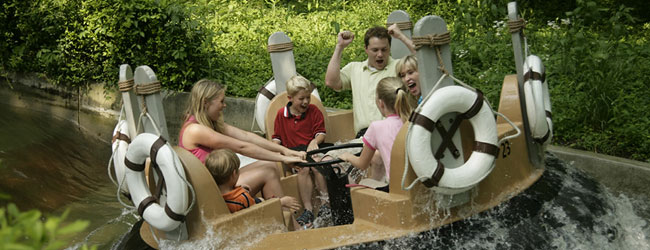 Family getting soaked in the Water Rafting Ride River Rampage at Dollywood wide