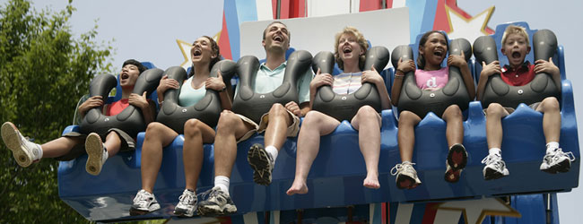 A group of six in the Shooting Star laughing and having fun in Dollywood wide