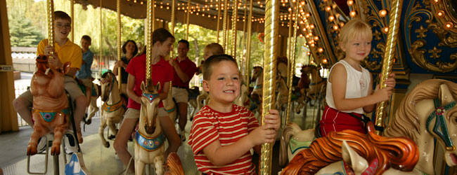 View of Kids riding on the Village Carousel Dollywood wide