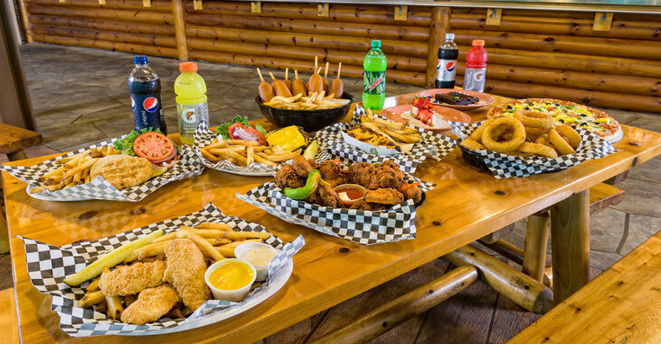 View of a table set with various dishes at the Roaring Fork Snack Bar at Westgate Smoky Mountain Resort