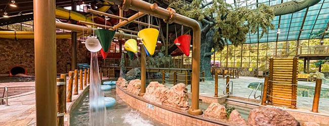 View of the Wild Bear Falls Water Park with Lazy River and 2 Large Water Slides in the background wide